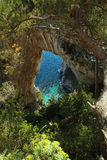 Arco Naturale Capri Italy. Natural formation found in Capri Italy. Mediterranean vegetation surrounding the area Royalty Free Stock Image