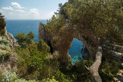 Arco Naturale Capri Italy. Natural formation found in Capri Italy. Mediterranean vegetation surrounding the area Stock Photography