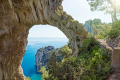 Arco Naturale is natural arch on coast of Capri island, Italy Royalty Free Stock Photo