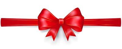 Arco rojo con las tiras del oro Fotos de archivo libres de regalías