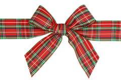 Arco rojo de la cinta de la tela escocesa del día de fiesta Fotografía de archivo libre de regalías