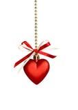 Arco rojo de la cinta del corazón y de la seda Fotografía de archivo