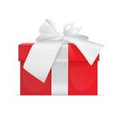 Arco rojo de la cinta del presente de la caja de regalo Foto de archivo libre de regalías