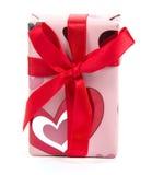 Arco rojo de la cinta del regalo Imagenes de archivo
