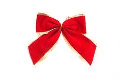 Arco rojo del algodón con la trenza de oro aislada en el fondo blanco Fotos de archivo