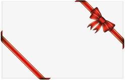 Arco rojo del regalo con las cintas Imagen de archivo libre de regalías