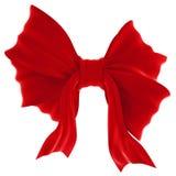 Arco rojo del regalo del terciopelo. Cinta. Aislado en blanco Imagen de archivo