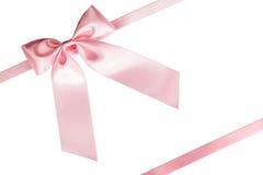 Arco rosa del nastro su bianco Immagini Stock