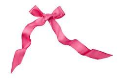 Arco rosa del raso isolato su bianco Immagine Stock