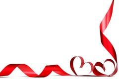 Arco rosso del nastro del cuore Fotografia Stock