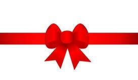 Arco rosso del nastro del regalo Fotografie Stock Libere da Diritti