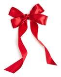 Arco rosso del nastro del regalo Fotografia Stock