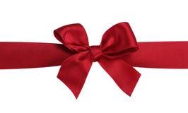 Arco rosso del regalo con il nastro. Immagine Stock Libera da Diritti