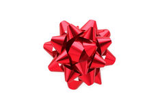Arco rosso del regalo sopra priorità bassa bianca Fotografia Stock Libera da Diritti