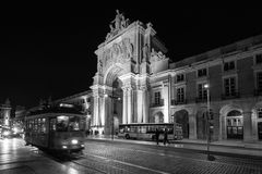 Arco Rua da Augusta - Lisbon. Side view of the Rua da Auguste Arch and the famous tramway in black and white Royalty Free Stock Photos