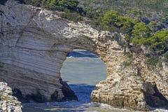 Arco San Felice. Well-known landmark of the Gargano coast in Apulia Royalty Free Stock Photo