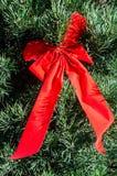 Arco su un albero di Natale Fotografia Stock Libera da Diritti