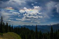 Arcobaleni della nuvola Immagine Stock