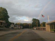 Arcobaleno e bandiera americana fotografia stock