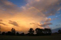 Arcobaleno sopra la nuvola di tempesta Fotografia Stock