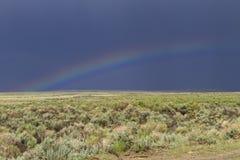 Arcobaleno sul pascolo del Wyoming Fotografia Stock Libera da Diritti