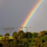 Arcos-íris e linhas eléctricas Fotografia de Stock Royalty Free