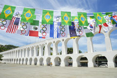 Arcos da Lapa Arches Rio de Janeiro Olympic Flags. RIO DE JANEIRO, BRAZIL - MARCH 6, 2015: Celebratory bunting featuring Brazilian and international flags hangs Stock Photography