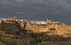 Arcos de la Frontera in Evening Light with Dark Clouds. Scenic view of Arcos de la Frontera, Andalusia, Spain, in Evening Light with Dark Clouds Royalty Free Stock Images
