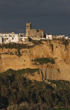 Arcos de la Frontera in Evening Light with Dark Clouds. Scenic view of Arcos de la Frontera, Andalusia, Spain, with San Pedro church in Evening Light with Dark Royalty Free Stock Photos
