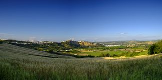Across the Andalucian fields view of the white town on Arcos de La Frontera, Spain royalty free stock photo