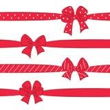 Arcos del rojo con las cintas Fotografía de archivo libre de regalías