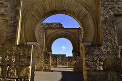 Arcos en Medina Azahara. The day I took this picture was perfect for photographic creativity, as there was radiant sun, white and black clouds, shadows Royalty Free Stock Photos