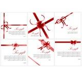 Arcos festivos rojos en la caja Foto de archivo