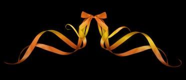 Arcs colorés de cadeau avec des rubans Photographie stock libre de droits