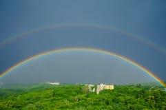 Arcs-en-ciel après pluie Photographie stock libre de droits