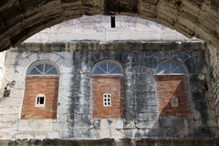 Arcs and wall. Arcs and stone wall of building in the center of Split, Croatia Stock Photo