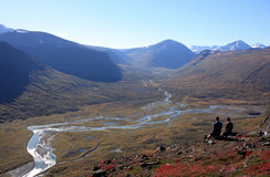 Arctic autumn view. 2 people enjoying the view of acrtic nature in the autumn, Sweden Stock Images
