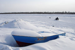 Arctic Blue Boat, Snowmobile & Dog Royalty Free Stock Photo