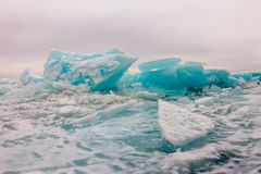 Arctic blue glacier ice hummock in cloudy weather Royalty Free Stock Photography