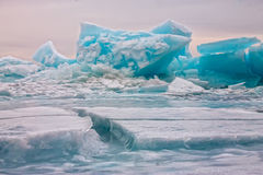 Arctic blue glacier ice hummock in cloudy weather Stock Photography