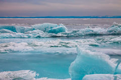 Arctic blue glacier ice hummock in cloudy weather Stock Photo
