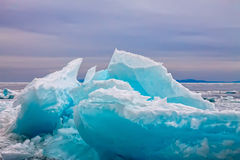 Arctic blue glacier ice hummock in cloudy weather.  royalty free stock photo
