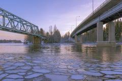 Arctic bridges. Motorway and railway bridges over frozen river Royalty Free Stock Images
