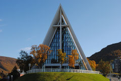 Arctic Cathedral in Tromsø. The Arctic Cathedral, formally known as Tromsdalen Church or Tromsøysund Church (Norwegian: Tromsdalen kirke or Tromsøysund kirke Stock Photo