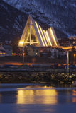 The arctic cathedral in Tromso reflected in the fjord. Royalty Free Stock Photos