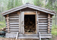 A wooden cabin for keeping firewood royalty free stock photos