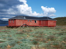Arctic circle trail hut, Greenland. This red hut is situated at the western end of the Amitsorsuaq lake in Greenland on the arctic circle trail Stock Image