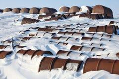 Arctic coast pollution - rusty fuel barrels Stock Images