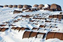 Arctic coast pollution - rusty fuel barrels Stock Image