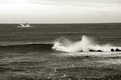 Arctic fishing. Fishing ship in ocean, Iceland, sepia toned Stock Photo